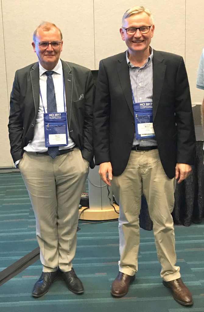 Dr. Rainer Lutze together with HCI International Session Chair Prof. Dr. Christian Märtin, Augsburg University of Applied Sciences, Germany